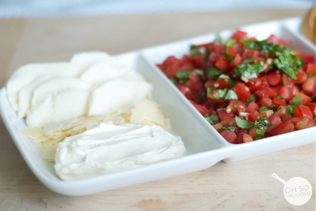 A close up of mozzarella and parmesan for making an easy bruschetta bar