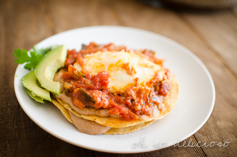 A close up of Huevos Rancheros on a white plate